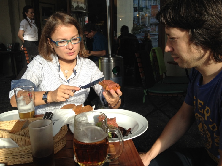 Kristyna and Yakob showing us how to eat Topinky